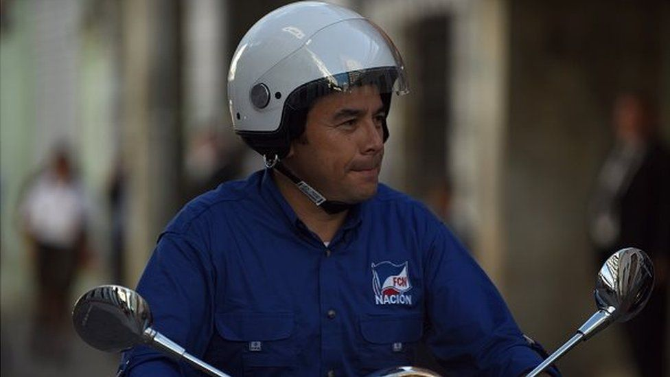 The presidential candidate for the National Front of Convergence (FCN) party, Jimmy Morales, drives on a motorbike during the closing rally of his campaign, in Guatemala City on 22 October, 2015