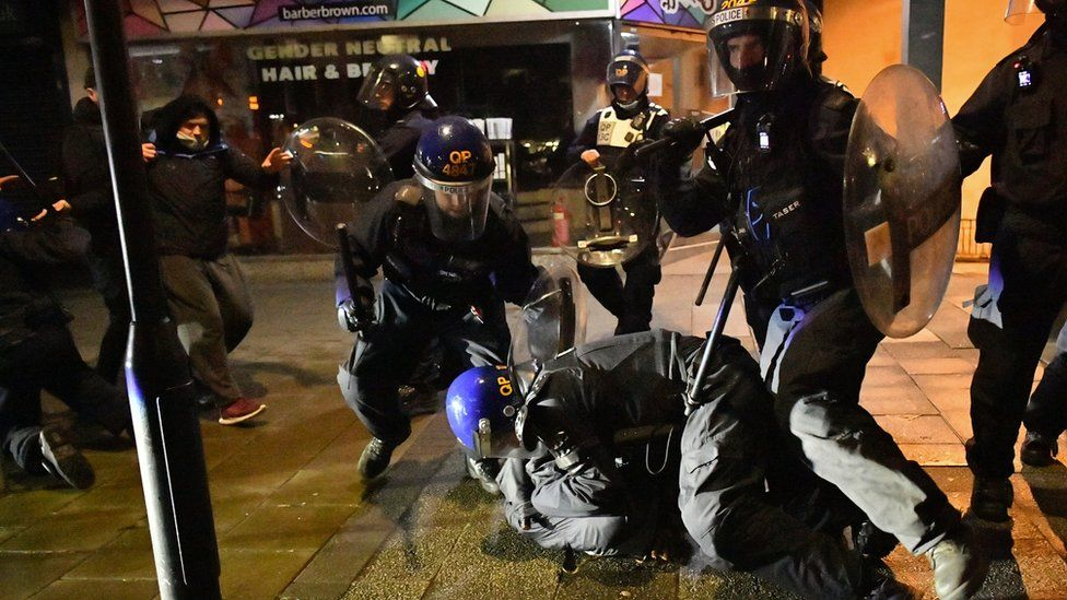 Police tackle protesters