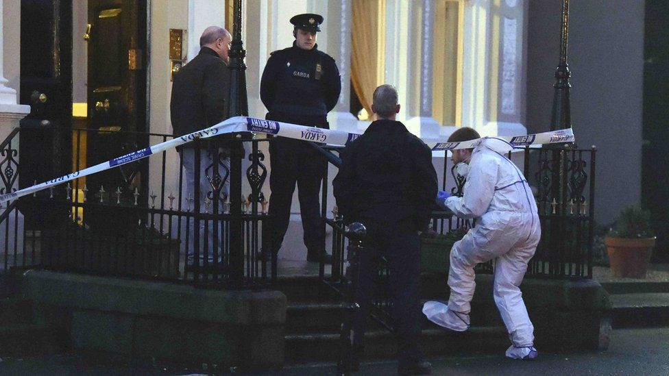 Police and forensic officers at the scene of the shooting at Dublin's Regency Hotel