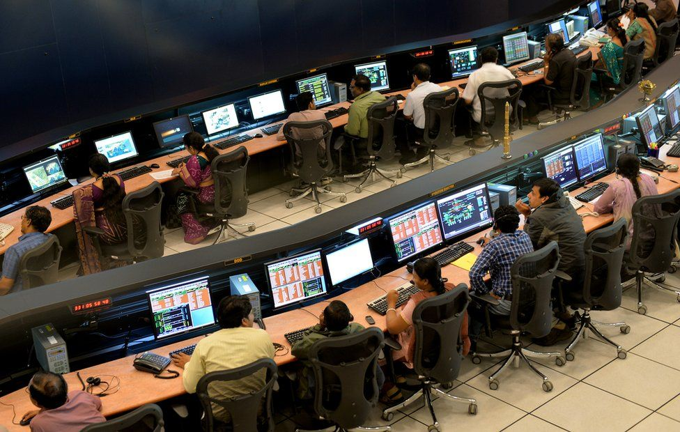 Isro scientists and engineers monitor the Mars Orbiter Mission (MOM) in Bangalore on November 27, 2013