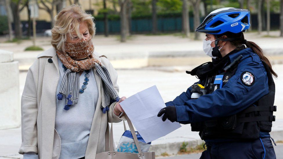 Police officer questioning woman, Paris