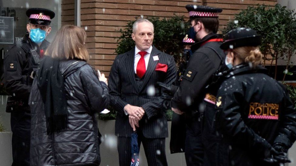 Brian Rose being spoken to by City of London police