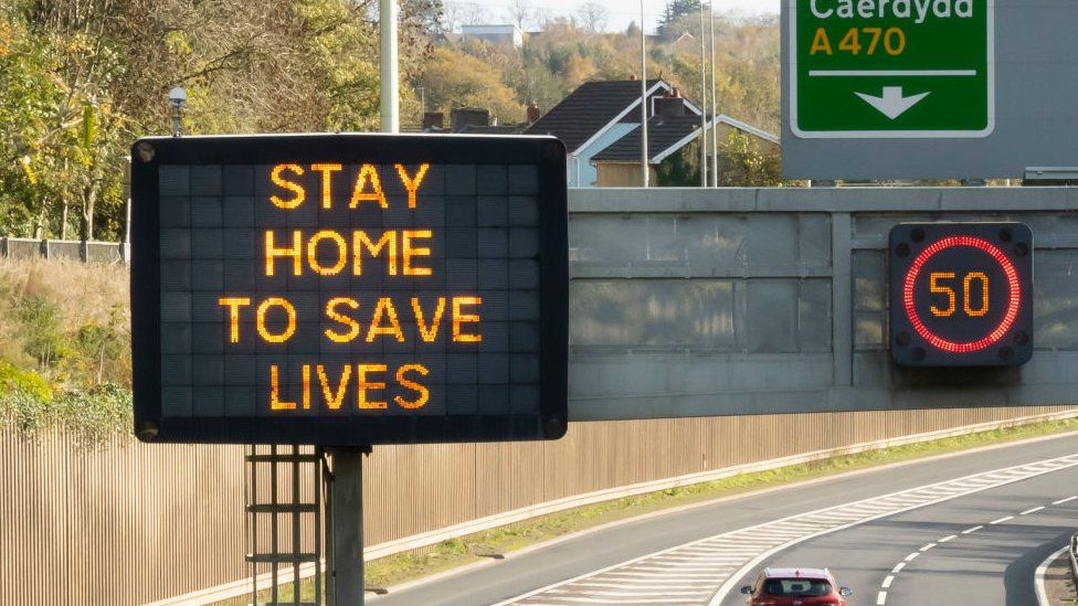 Stay home to save lives sign on motorway