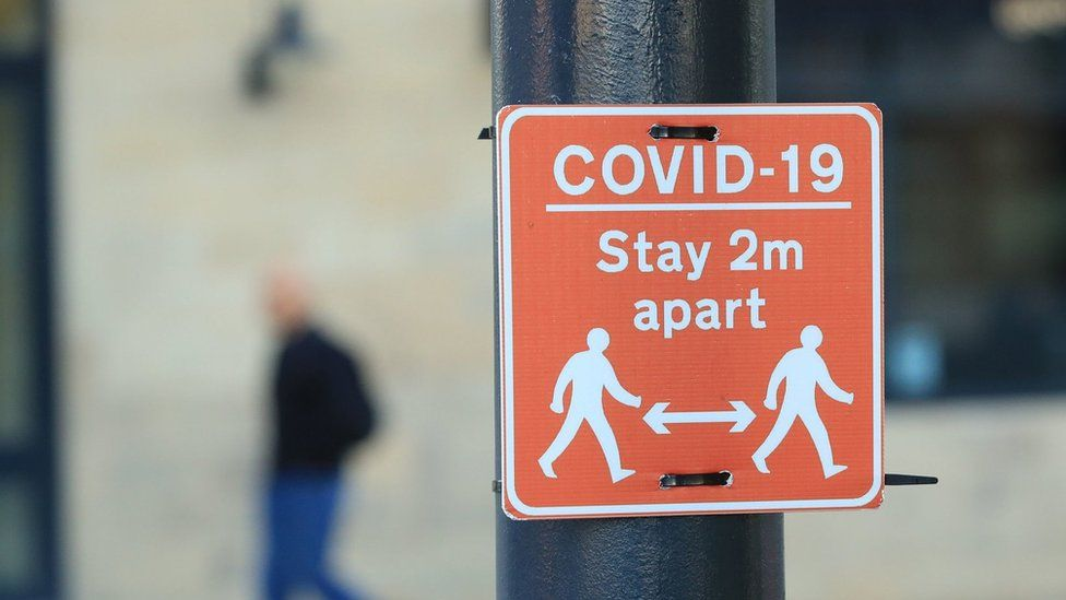 """A """"stay 2m apart"""" sign in Manchester"""