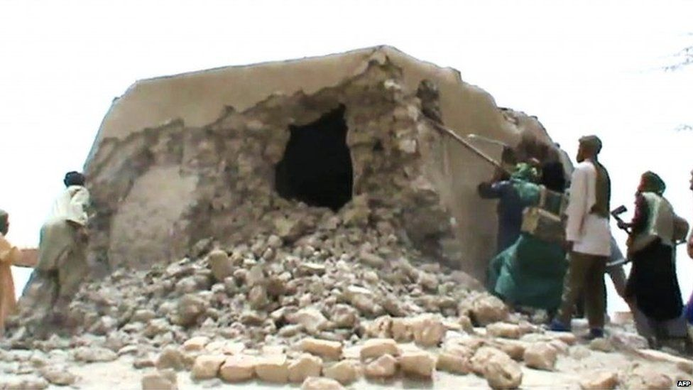 An archive image from July 2012 shows Islamist militants destroying an ancient shrine in Timbuktu