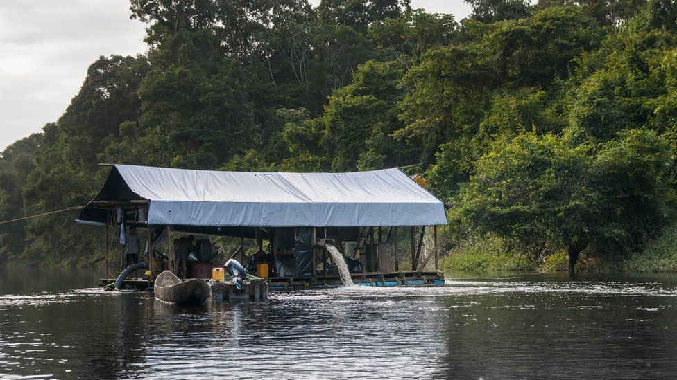 """A gold/diamond mining dredge in the Upper Potaro River above Chenapau Village. """"Gold and diamond mining pose immediate threats of negative impacts to aquatic ecosystems and fishes and to humans that eat fish potentially contaminated with mercury,"""" noted the report's researchers."""