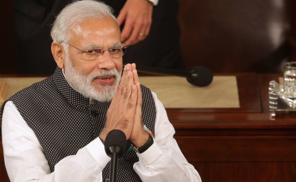 Indian Prime Minister Narendra Modi salutes while addressing a joint meeting of the U.S. Congress in the House Chamber of the U.S. Capitol June 8, 2016 in Washington, DC.