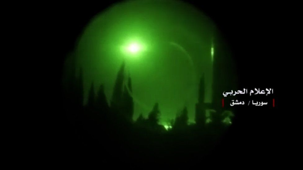 n explosion in the sky over Damascus seen through a night-vision device