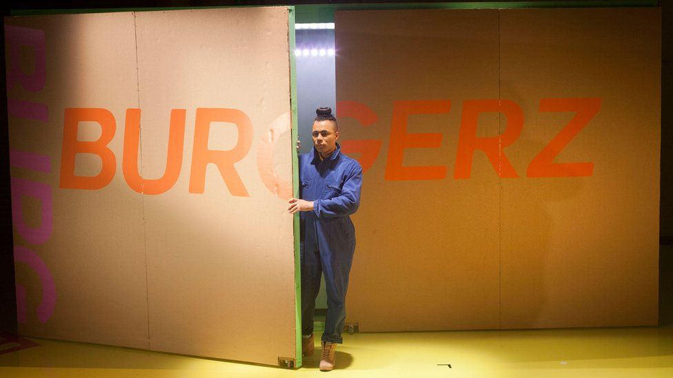 Travis in their production of Burgerz