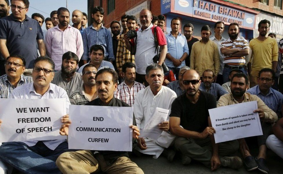 Kashmiri media persons hold placard during a stage a sit-in protest at Press Enclave in Srinagar summer capital of Indian Kashmir, 16 July 2016.