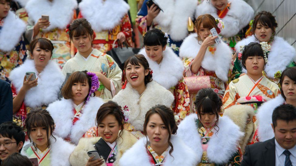 Women wearing kimonos leave after attending a Coming of Age ceremony on January 8, 2018 in Yokohama, Japan.