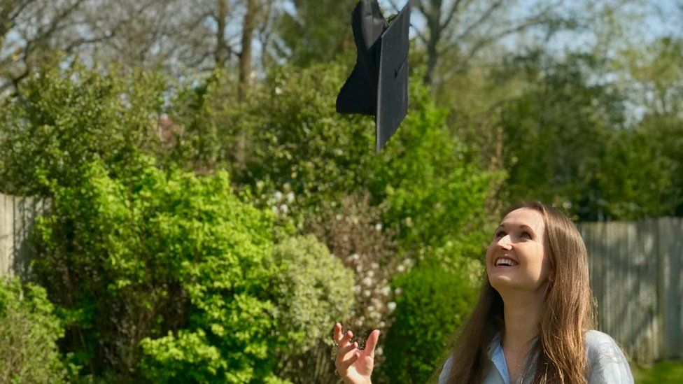 Molly Dineen throwing her mortarboard in the air