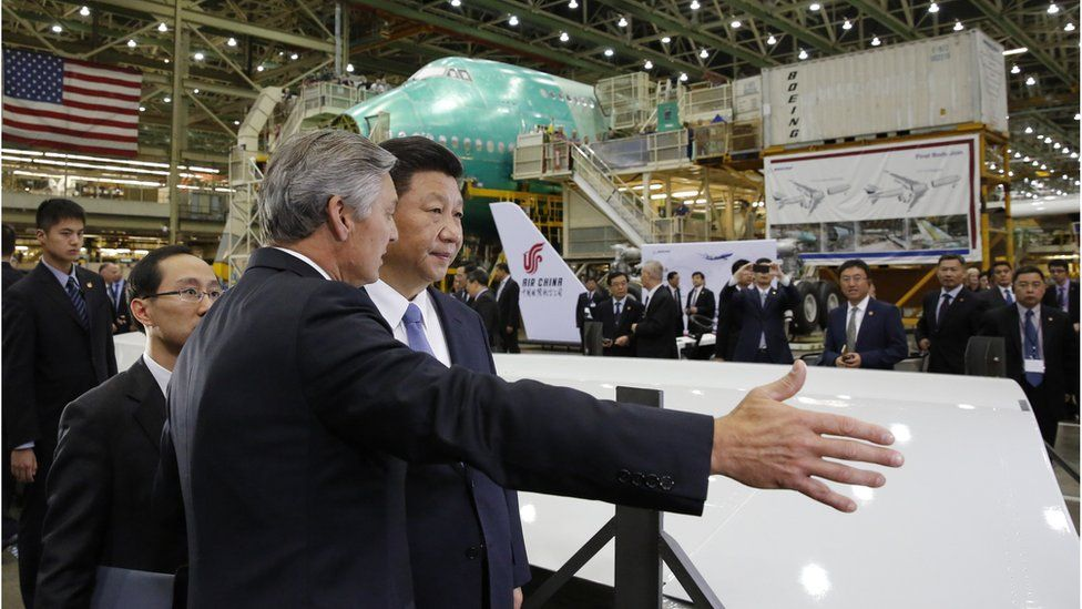 Chinese President Xi Jinping (R) and Ray Conner, president and CEO Boeing Commercial Airplanes, tour the Boeing assembly line on September 23, 2015,