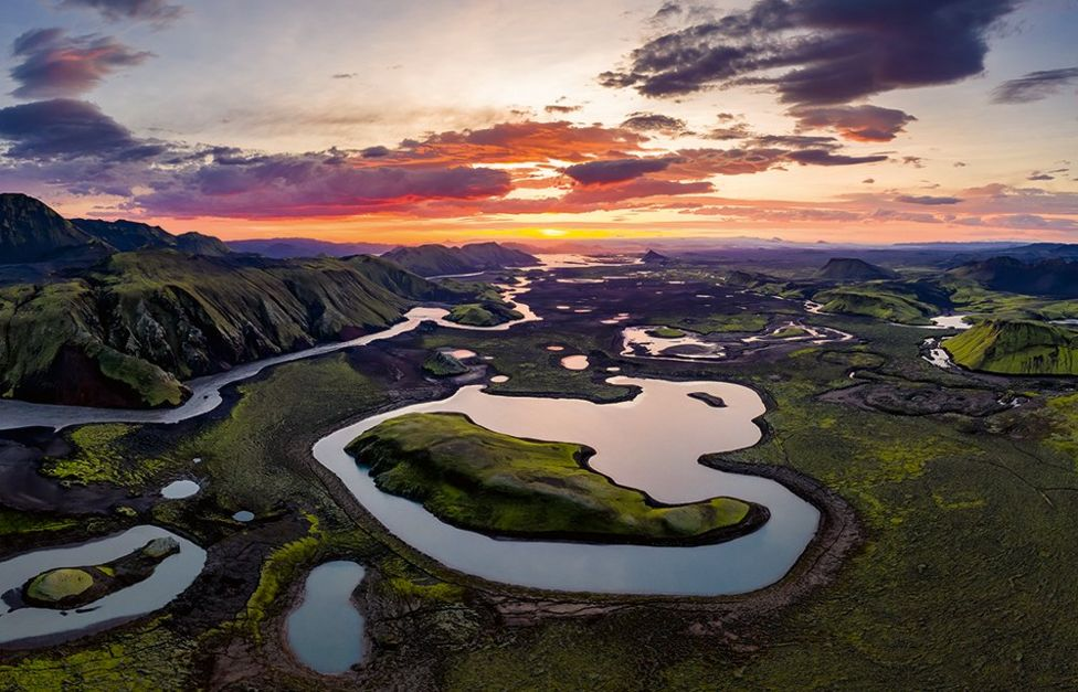 A landscape showing many lakes at sunrise
