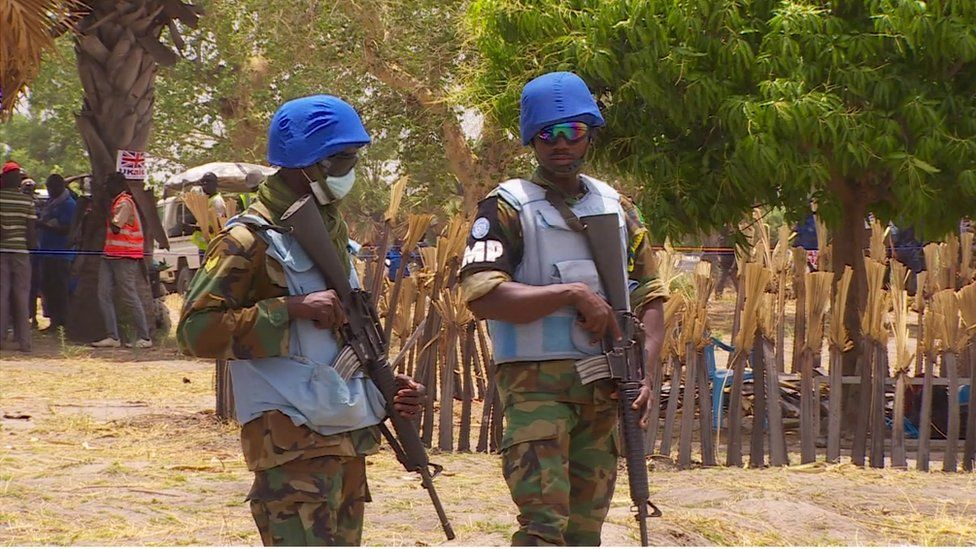 Armed men during a food drop in South Sudan