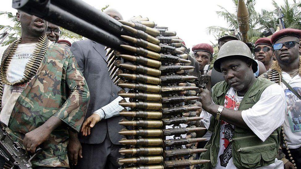 A militant examines a machine gun