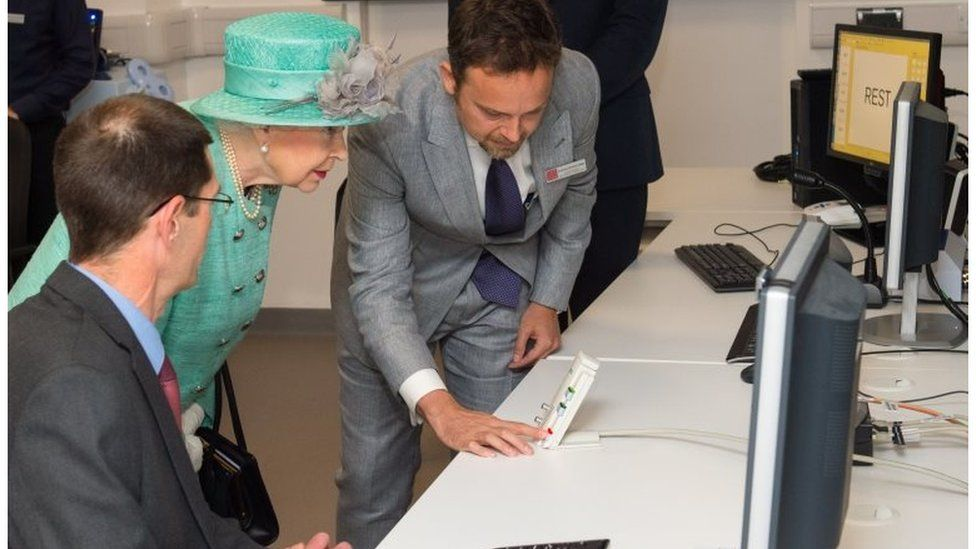 The Queen uses an intercom to speak to a patient in a scanner