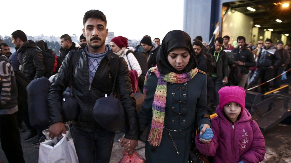 Refugees and migrants arrive aboard the passenger ferry Eleftherios Venizelos from the island of Lesbos at the port of Piraeus, near Athens