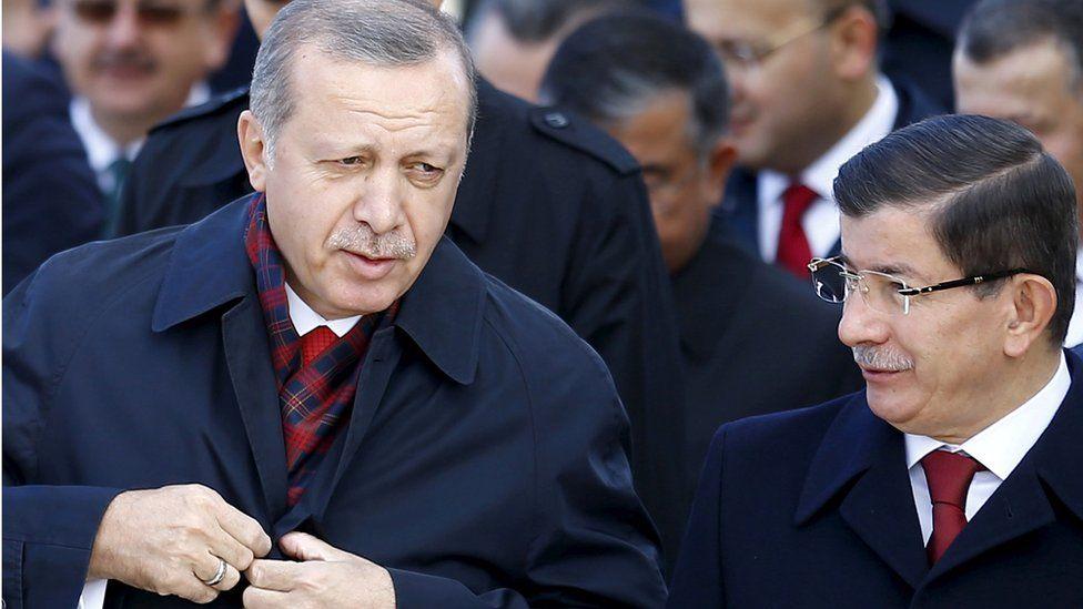 Recep Tayyip Erdogan (L) with Ahmet Davutoglu (R) (file pic)