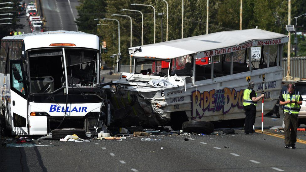 The scene of a fatal crash between a tour bus and a tourist duck boat on the Aurora Bridge in Seattle, Washington, 24 September 2015. At least four people were killed and several were critically injured when a bus collided with a tour vehicle on a bridge in the US West Coast city of Seattle, officials said.