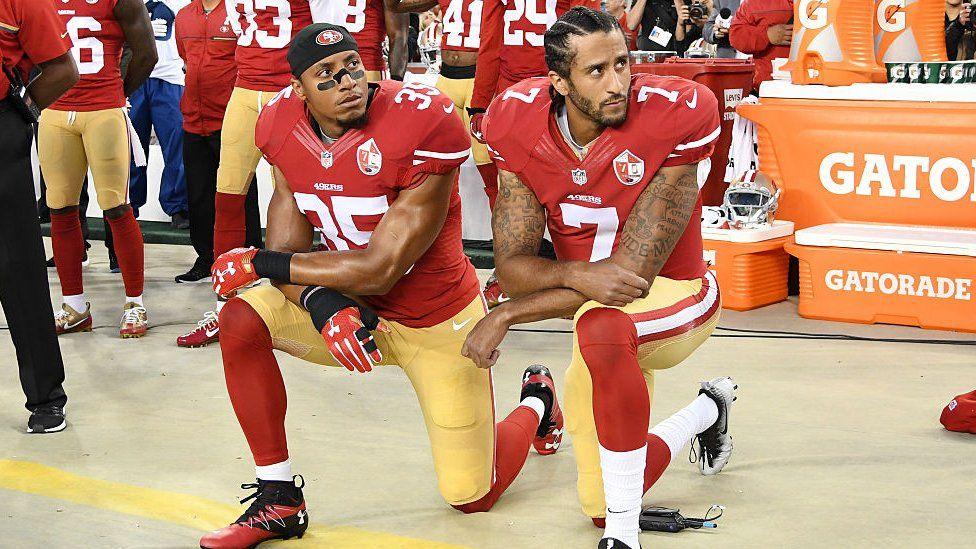 American football players Eric Reid and Colin Kaepernick