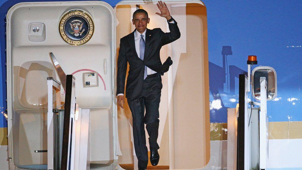 US President Barack Obama steps off Air Force One on his arrival at Stansted airport on 21 April 2016