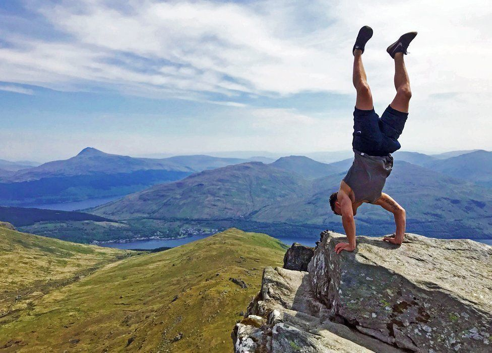 John Trippick admiring the upside down view from The Cobbler after climbing with friends on a gloriously sunny Sunday.