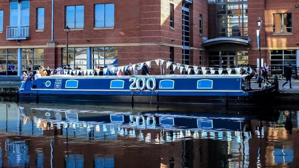 Canal boat with '200' balloon