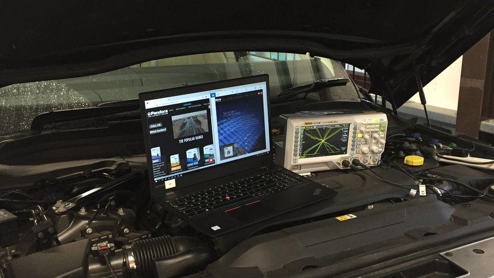 Laptop on car engine