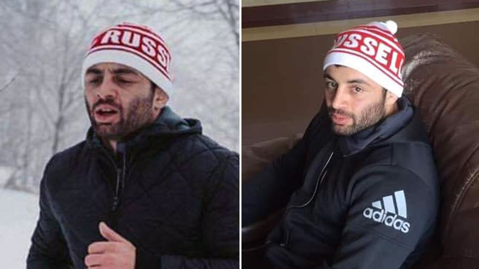 Two photos of the wrestler, one which appears he has a hat with 'RUSS' written on it, the other from the side, showing the rest of the text spelling 'RUSSELL'