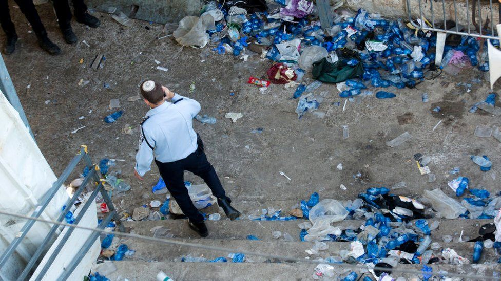 A police officer walks at the scene