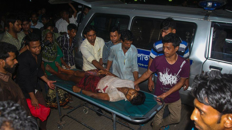 An injured Bangladeshi man is carried on a stretcher at Chittagong hospital in Chittagong on April 4, 2016, after a protest at Banshkhali turned violent