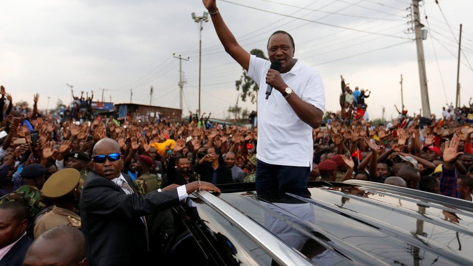 President Uhuru Kenyatta addresses his supporters at Burma market after his election win was declared invalid by the Supreme Court in Nairobi, Kenya, September 1, 2017.