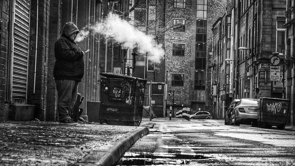A man smoking outside