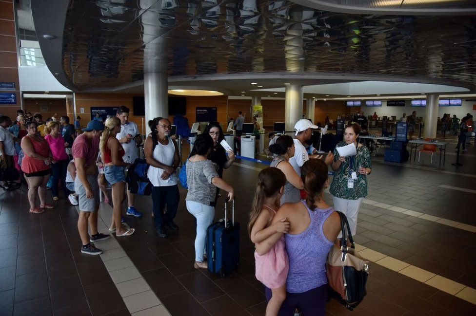 Hundreds have been sleeping at the airport, hoping for a flight out of San Juan