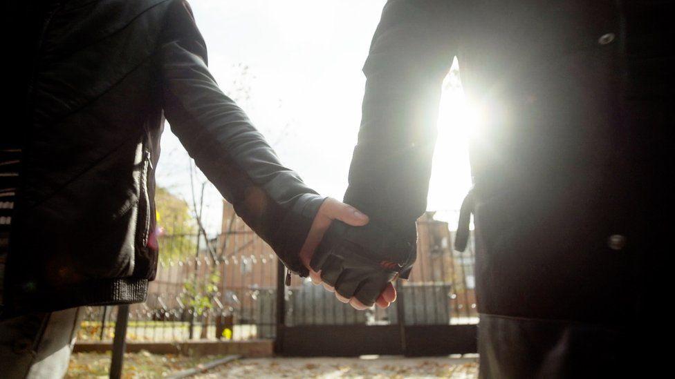 Lasha and Beka hold hands