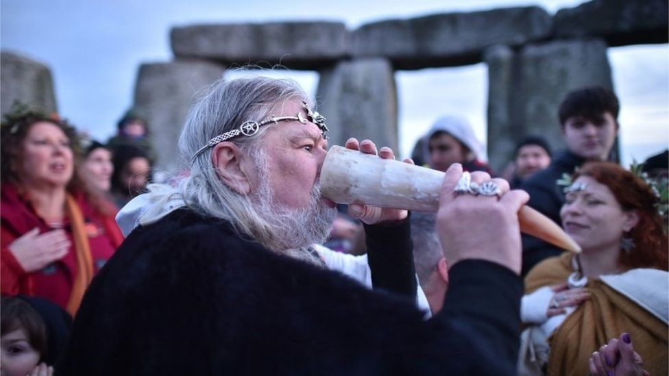 Man drinks from horn