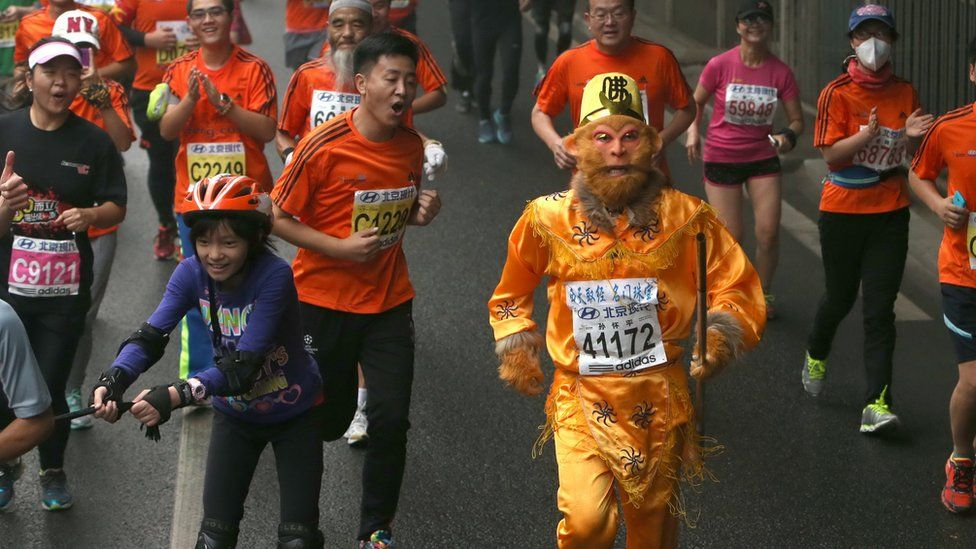 A participant dressed as Monkey God, takes part in the Beijing Marathon