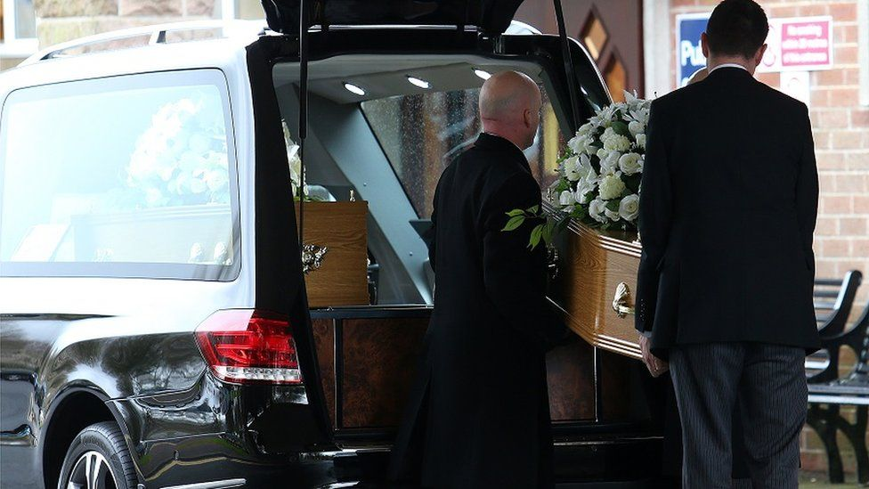 Coffins and hearse