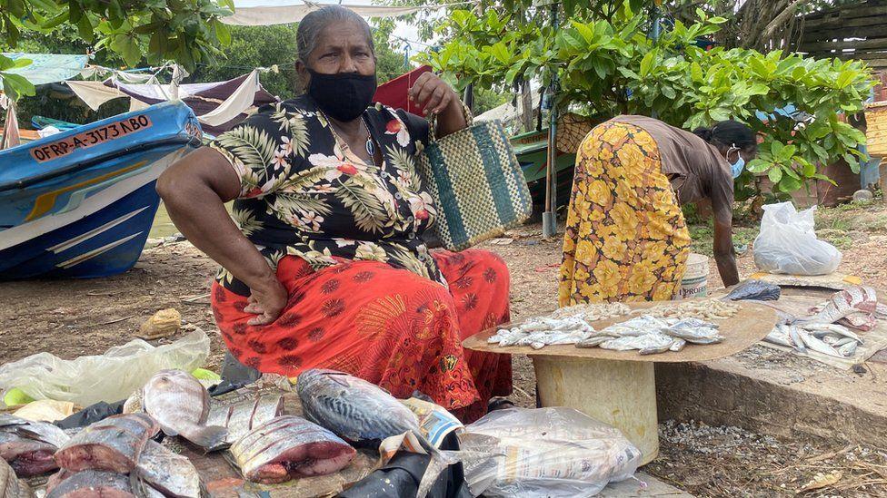 Woman selling fish