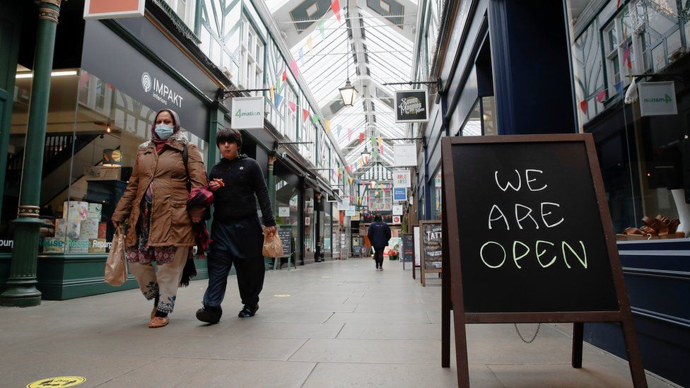 People walk at The Arcade shopping mall, amid the spread of coronavirus disease (COVID-19), in Bedford town centre,