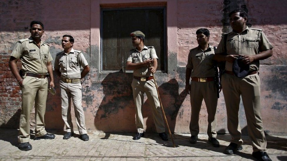 Indian policemen stand guard near the house of Akhalaq Saifi, who was killed by a mob, at Bisara village in Uttar Pradesh, India, October 2, 2015.