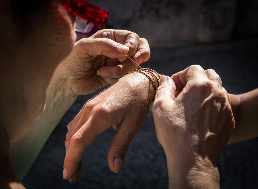 Chiara tying bracelet