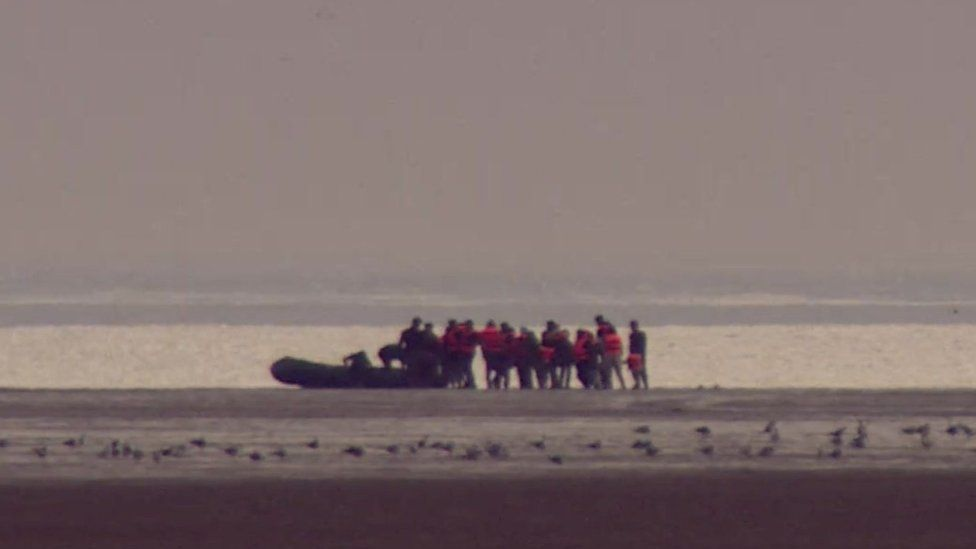 Migrants setting off from France in a boat