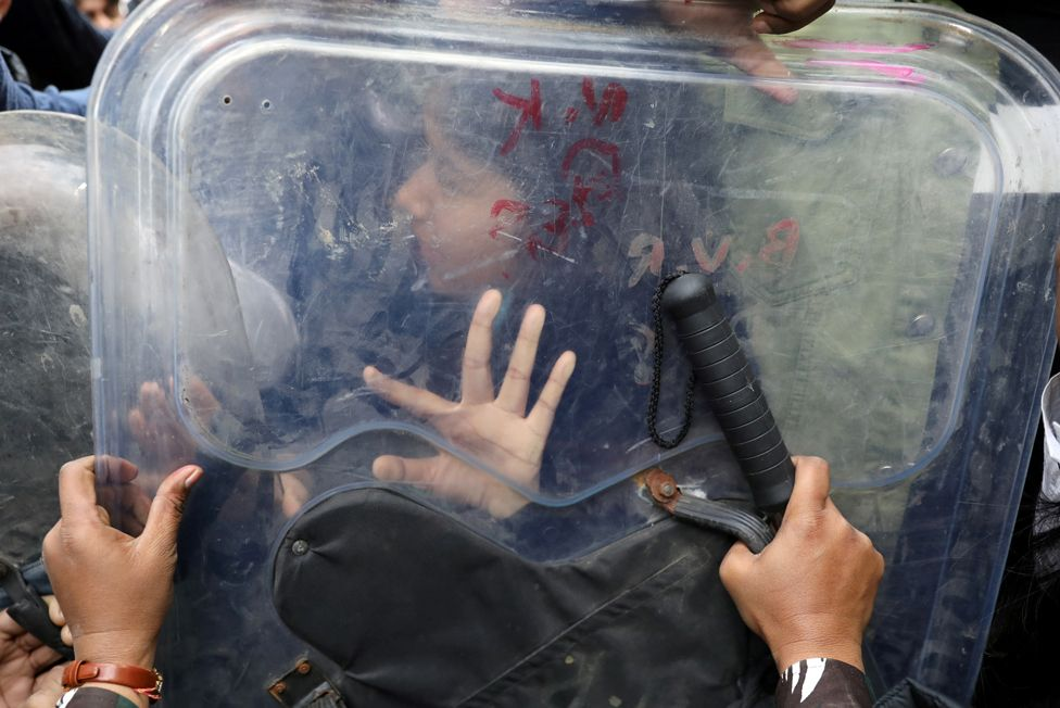 A demonstrator clashes with a police shield at a rally in Delhi, India, on 3 February 2021