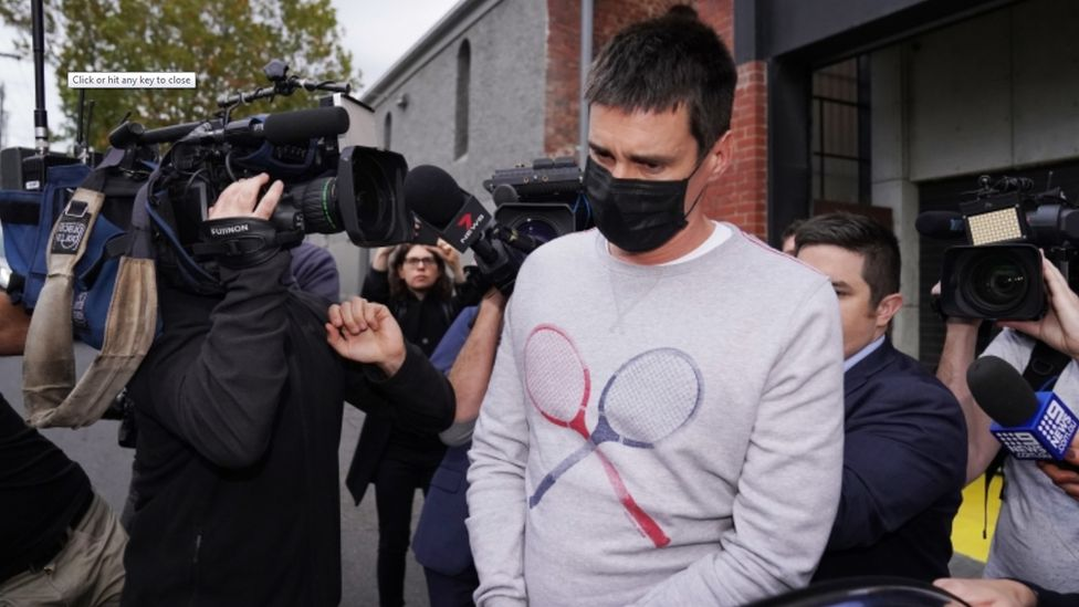 Melbourne man Richard Pusey surrounded by media as he's arrested by police