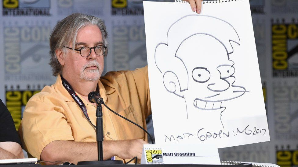 Matt at the 2017 Comic-Con in San Diego, holding up a picture of Apu