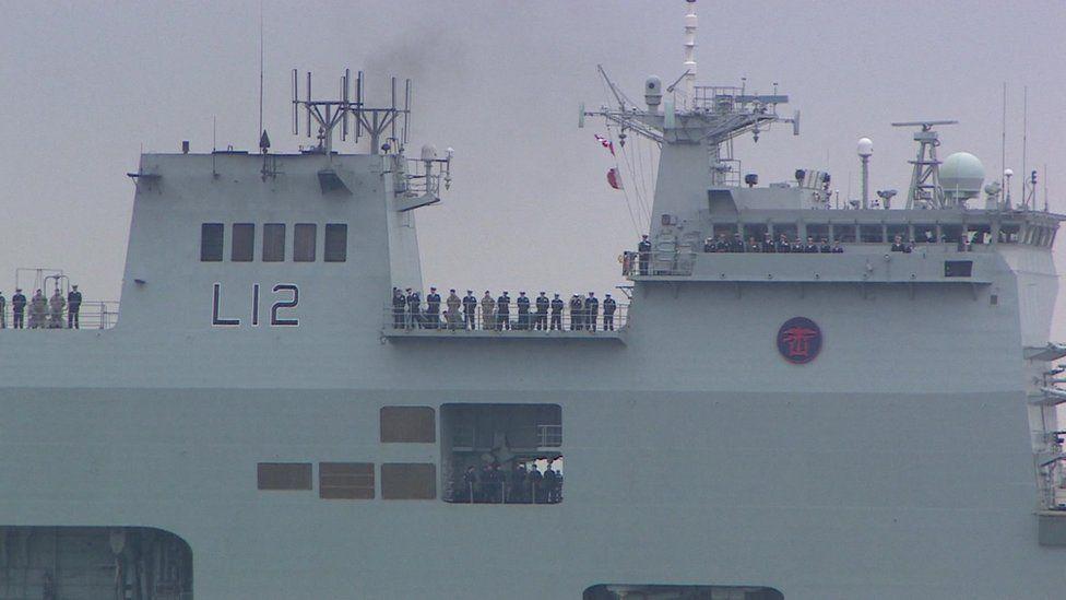 Navy crew on decks of HMS Ocean
