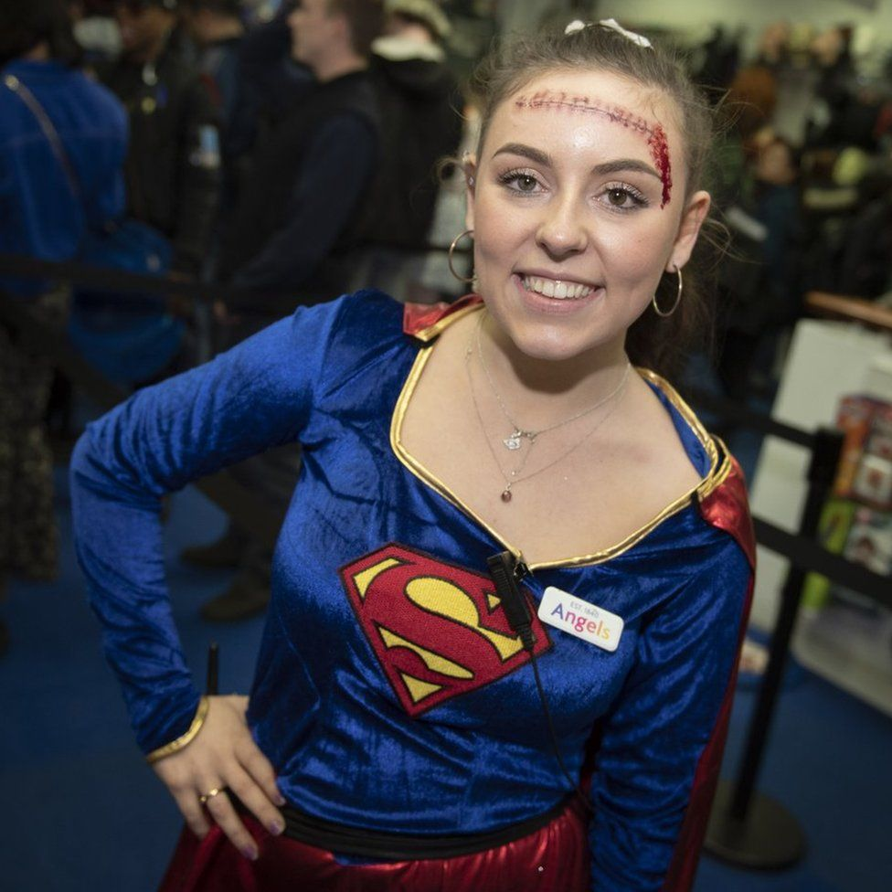 Girl dressed up as Superwoman