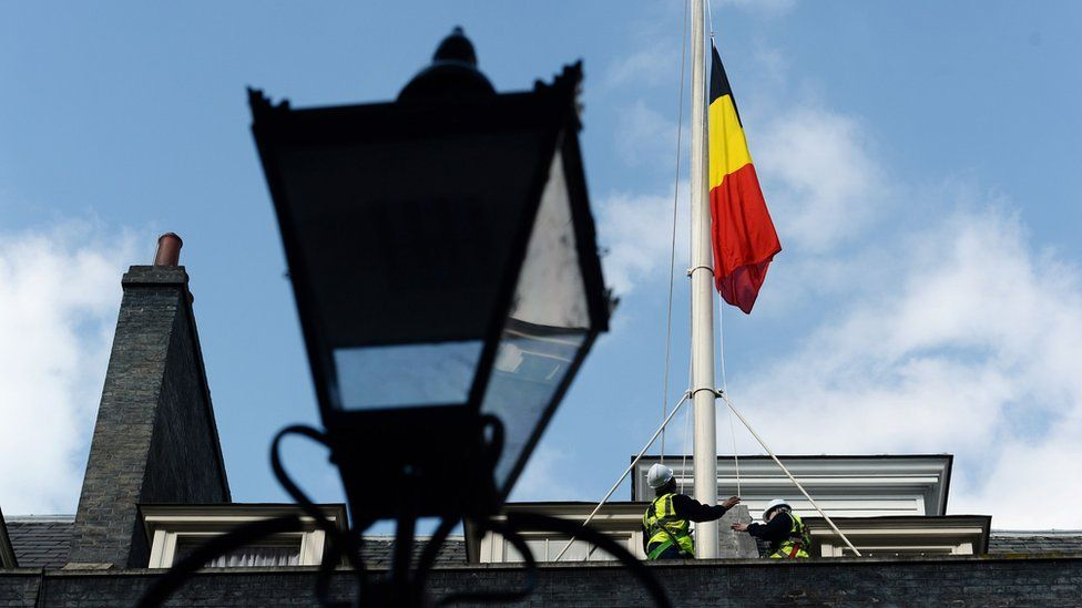 The Belgian flag flies at half mast above 10 Downing Street in London